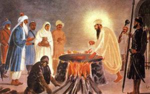 Guru Arjan Dev boiled in hot water