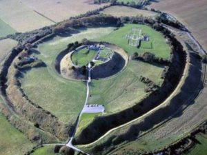 An aerial photograph of the site. The newly discovered probable royal palace is under the grass in the quadrant opposite the foundations of the cathedral. The enormous earthworks surrounding the site are from the Iron Age.The earthwork in the center is the medieval castle mound.