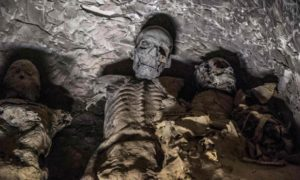 A group of mummies stacked together at the Al-Assasif necropolis.