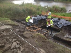 GUARD Archaeologists recording the medieval harbour