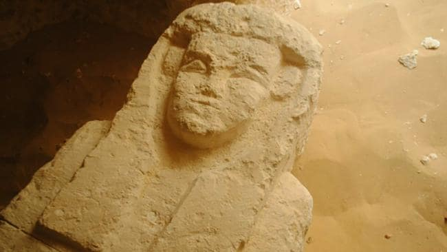 A handout picture released by the Egyptian Antiquities Ministry shows a sarcophagus which was in one of three tombs that were discovered at cemetery dating back about 2,000 years in the al-Kamin al-Sahrawi area in Minya province, south of Cairo.