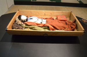 The body of the woman in the tomb was buried lying inside a wooden cart, a burial method common for important Viking women, like this reconstruction of the grave at Silkeborg Museum.