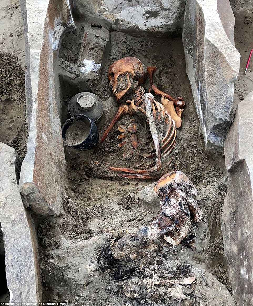 The 2,000-year-old remains of a 'sleeping beauty' buried in lavish clothes and carrying gifts for the afterlife have been found under a Russian reservoir. The 'sleeping beauty' became accidentally mummified as the stone tomb preserved her body. Pictured is the full grave while