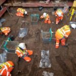 Archaeological work to remove 45,000 skeletons from a burial site to make way for HS2 construction has begun.