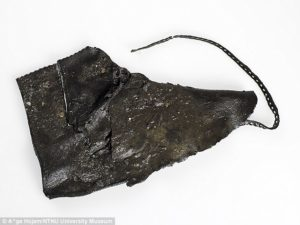 Alongside the toy boat, the archaeologists also found leather pieces that they believe piece together to form four shoes