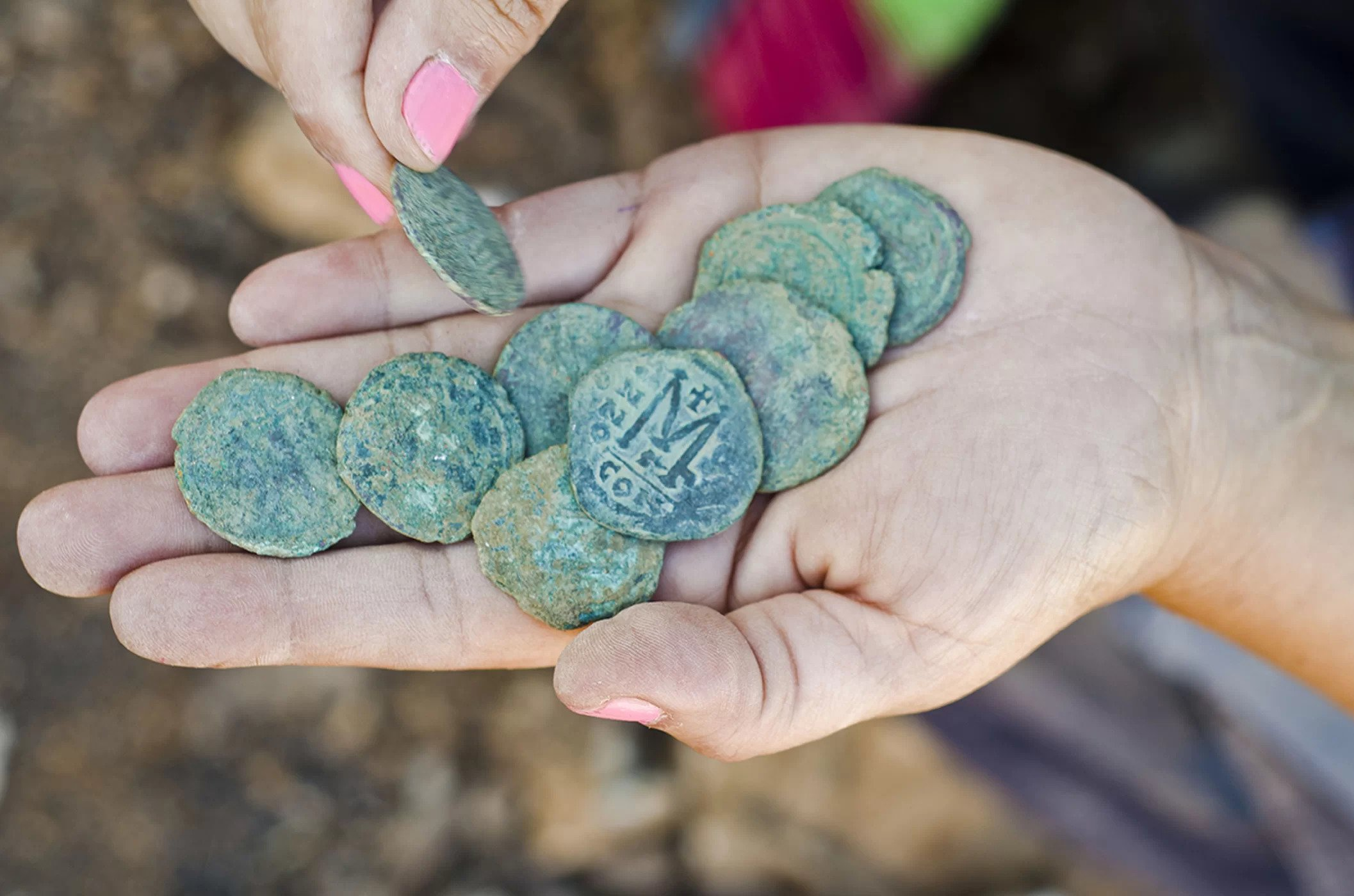 Nine bronze coins dating to the Byzantine period were found in the remains of a settlement near a highway to Jerusalem.