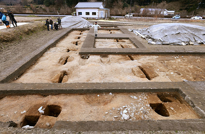 The pits in the ground suggest the ancient structure in Asuka, Nara Prefecture, measured at least 19.2 meters west to east.