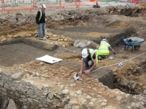 Excavating the stone lined water channel and refectory