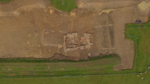 Aerial view of the remains, showing the foundations of the medieval building to the right and the foundations of the older Roman building underneath