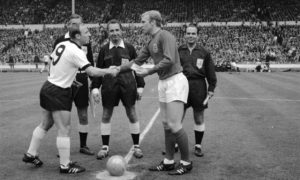 German captain Uwe Seeler (left) shakes hands with England captain Bobby Moore before the start of the World Cup final at Wembley in 1966. A major genetic study has revealed different genetic clusters across the UK, but overall white Britons share 30% of their DNA with modern Germans.