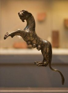 """The silver """"Hoxne Tigress"""" – the broken-off handle from an unknown object – is the best known single piece out of some 15,000 in the hoard."""