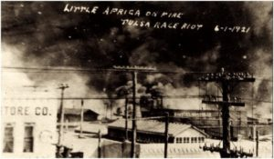 Fires burning along Archer and Greenwood during the Tulsa race riot of 1921