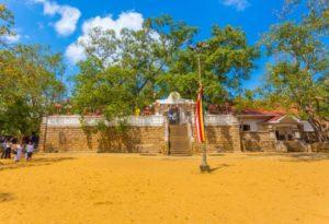 Anuradhapura, Sri Lanka – February 7, 2015: Dirt field and south compound steps lead to sacred Jaya Sri Maha Bodhi or Bodhiya fig tree in Anuradhapura