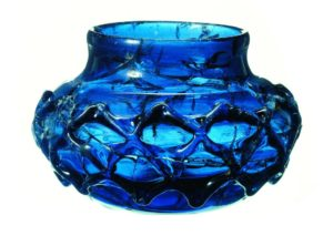 One of two rare blue glass decorated beakers. The two were almost certainly made as a matching pair and discovered in tact within the burial chamber