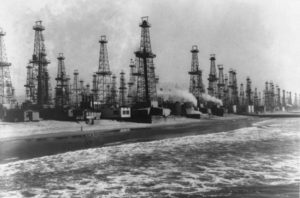 Oil wells at Venice, California, a suburb of Los Angeles, which are bringing oil up from beach area.