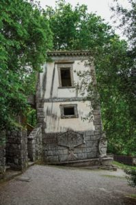View of house amidst the vegetation in the Park of Bomarzo. Also known as Park of Monsters, it was created to surprise the visitor with surrealistic works in stone. Lazio region, central Italy