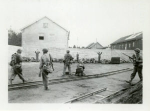 American troops prepare to execute Nazi personnel at Dachau following the camp's liberation on April 29, 1945.
