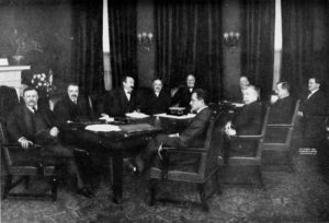 Group portrait of the cabinet of President of the United States Theodore Roosevelt (at far left). Left to right in back of table: George B. Cortelyou, Charles Joseph Bonaparte, x, James Wilson, Truman Handy Newberry. Left to right in front of table: x, Luke Edward Wright, George von Lengerke Meyer, James Rudolph Garfield