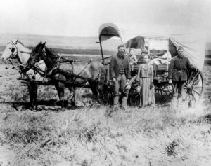 A Covered Wagon, like the ones used by the Baker-Fancher Party, during the Great Western Migration, 1886 in Loup Valley, Neb.