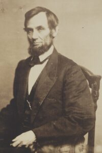 May 16, 1861-President Abraham Lincoln, three-quarter length portrait, seated, wearing his pocket watch