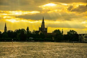 Scenic sunset and view of the old town of Konstanz on Lake Constance, with the cathedral in the center of the image. Bodensee, Germany.