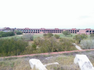 The perimeter of the entire structure is surrounded by a moat and then walkway.