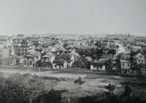 View of St. Augustine from the former San Marco Hotel, Spanish St. on left, Huguenot Cemetery lower left corner, Cordova St. on right