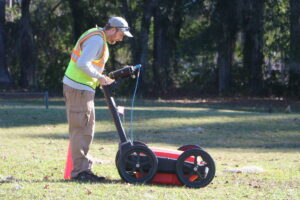 National Parks Service archaeological technician Andrew McFeaters pushes a Ground Penetrating Radar device over the site where archaeologists say a forgotten cemetery of about 40 graves has been found at Capital City Country Club in Tallahassee.
