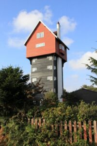 The House in the Clouds. A water tower in Thorpeness. Built in 1923 to receive water pumped from Thorpeness Windmill and designed to improve the looks of the water tower, disguising the tank with the facade of a weatherboarded building more in tune with the mock-Tudor and Jacobean style of Thorpeness.