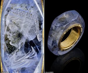 """Mysterious beautiful face engraved on a 2,000-year-old sapphire ring of the Roman emperor. Close-up of the beautiful face engraved on the """"Caligula ring""""."""