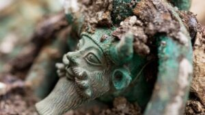 A bronze cauldron which forms one of the centre pieces of the tomb had several large rings around its edge, each adorned with the horned, bearded head of Acheloos, the Greek river god