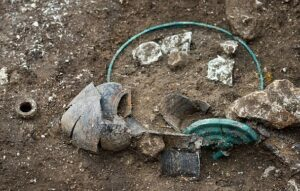 Funeral deposits including bronze and ceramic dishes were found in the tomb, which is dated to the early fifth century BC