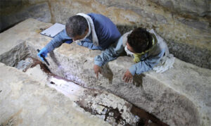 In a tomb deep below the desert, Egyptologist Ramadan Hussein (left) and mummy specialist Salima Ikram (right) examine the coffin of a woman who was laid to rest inside a limestone sarcophagus weighing more than seven tons.