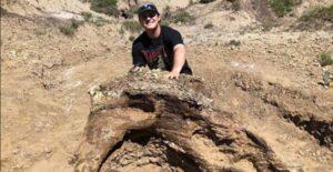 Harrison Duran with the triceratops skull in North Dakota