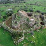 WHO ERECTED MORE THAN 7000 ANCIENT NURAGHE TOWERS ON AN ITALIAN ISLAND?